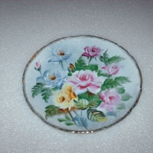 Vintage hand-painted, gold-rimmed plate of roses